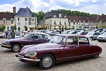 Traditional Citroen DS saloon cars in Place du Marche town square, Richelieu, France