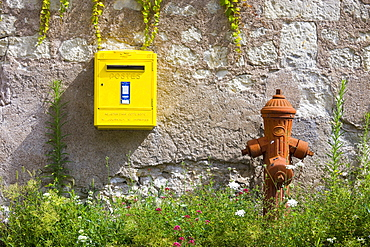 Traditional water hydrant and letter box at Parnay in the Loire Valley, France