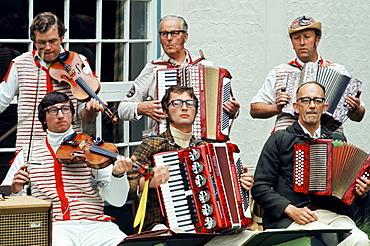 Traditional English Morris Men in costume at a Morris dancing festival in Cambridge, UK