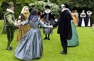 Dancers in costumes re-enact Elizabethan days and traditional dance in Middle England, United Kingdom