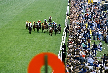 Crowds of spectactors by winning post at the racetrack at Epsom Racecourse for Derby Day, UK