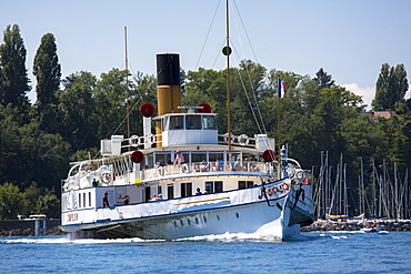 Old paddle steamer ferry crosses Lac Leman (Lake Geneva), from Evian-les-Bains, Rhone-Alpes, France, Europe