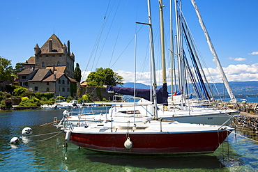 Yachts by the 12th century medieval castle in the old port of Yvoire on Lac Leman (Lake Geneva), Rhone-Alpes, France, Europe