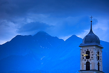 Nighttime scene of traditional church in the Swiss Alps, Graubunden region of Eastern Switzerland, Europe