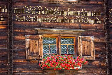 Traditional inscription on 18th century Swiss house built 1741 in Serneus near Klosters, Graubunden region, Switzerland, Europe