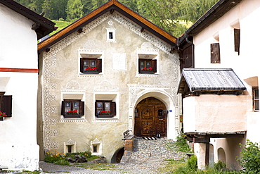 House in the Engadine Valley in the village of Guarda with old painted stone 17th century buildings, Graubunden, Switzerland, Europe