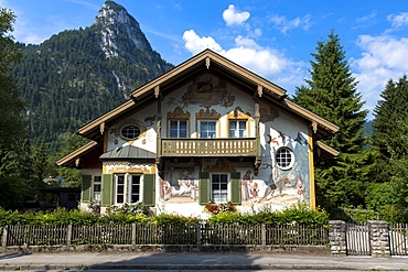 Painted facade of Grimms Fairy Tale story of Little Red Riding Hood in the village of Oberammergau in Bavaria, Germany, Europe