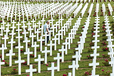 Man visiting the Cemetery of Douaumont (Ossuaire de Douaumont) at Fleury-devant-Douaumont near Verdun, Meuse, Lorraine, France, Europe