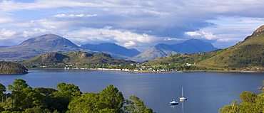 Picturesque fishing village of Shieldaig across sea loch of Loch Torridon in Argyll, Wester Ross in the Highlands of Scotland, United Kingdom, Europe