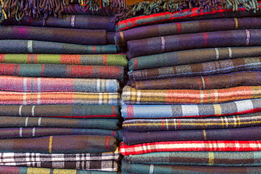 Traditional checks, plaid and Highland clan tartan lambswool throws and textiles on display for sale at Lochcarron Weavers at Lochcarron in the Highlands of Scotland, United Kingdom, Europe