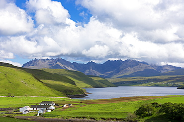 Clouds over the Cuillin mountain range with croft farm and Loch Harport near Coillure, Isle of Skye, Highlands and Islands, Scotland, United Kingdom, Europe