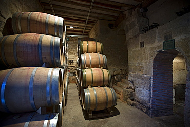 Rioja wine in American oak barrels in cave at Bodegas Agricola Bastida in Rioja-Alavesa area of Basque country, Euskadi, Spain. Europe