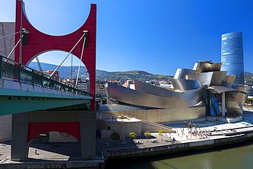 Guggenheim Museum, Iberdrola Tower skyscraper and Red Bridge in Bilbao, Basque country, Euskadi, Spain, Europe