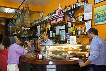 Locals in traditional Spanish tapas raciones Bar Restaurante Bikandi in central Bilbao, Euskadi, Spain, Europe