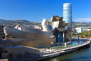 Frank Gehry's Guggenheim Museum, The Spider sculpture, Iberdrola Tower and River Nervion at Bilbao, Euskadi, Spain, Europe