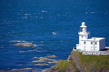 Speedboat passes Hartland Point Lighthouse, 19th Century Grade II listed, Atlantic Ocean and Bristol Channel in North West Devon, Devon, England, United Kingdom, Europe