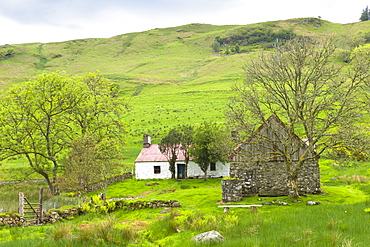 Quaint cottage dwelling and old stone barn at Auchindrain, Highland farming township settlement and village folklore museum at Furnace near Inveraray in the Highlands, Scotland, United Kingdom, Europe