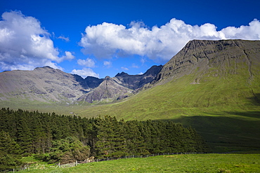 Puffy white cumulus clouds over iconic Cuillin mountain range, Isle of Skye, Inner Hebrides, Highlands and Islands, Scotland, United Kingdom, Europe