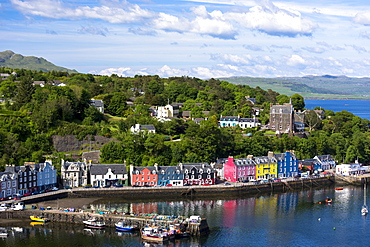 Multi-coloured buildings on the waterfront of Sound of Mull at Tobermory, Isle of Mull, Inner Hebrides, Scotland, United Kingdom, Europe