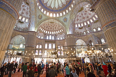 Tourists view embellished ornate domes of the Blue Mosque, (Sultanahmet Camii) (Sultan Ahmet Mosque) (Sultan Ahmed Mosque), UNESCO World Heritage Site, 17th century monument in Istanbul, Turkey, Europe