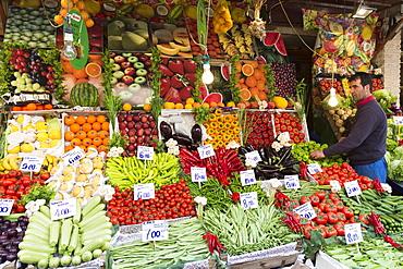 Shopkeeper with fresh fruit and vegetables with Turkish lira prices at food market Kadikoy, Asian Istanbul, Turkey, Asia Minor, Eurasia