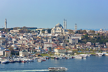 Skyline cityscape and the Blue Mosque and passenger ferry on Bosphorus in Istanbul, Turkey, Europe, Durasia