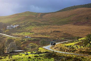 Truck driving through the Brecon Beacons for logging timber production, Powys, Wales, United Kingdom, Europe