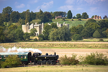 Steam train of the Kent and East Sussex Railway and Bodiam Castle, a National Trust tourist attraction, East Sussex, England, United Kingdom, Europe