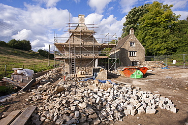 Home improvement, a renovation project restoring a 17th century Cotswold old stone cottage in Swinbrook in the Cotswolds, Oxfordshire, England, United Kingdom, Europe