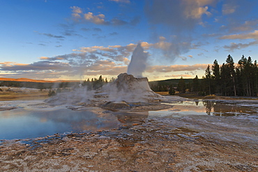 Castle Geyser at sunset, Upper Geyser Basin, Yellowstone National Park, UNESCO World Heritage Site, Wyoming, United States of America, North America