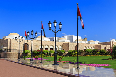 Polished pavements, National Flags, lush lawns and flowers in bloom, Sultan's Palace, Old Muscat, Oman, Middle East