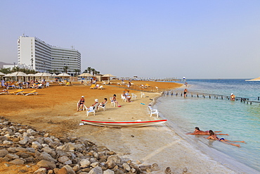 Ein Bokek (En Boqeq) beach, with bathers in the turquoise sea and relaxing ashore, Dead Sea, Israel, Middle East