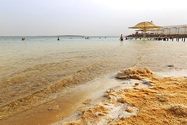Bathers in the Dead Sea, with salty shoreline, Ein Bokek (En Boqeq) beach, Israel, Middle East