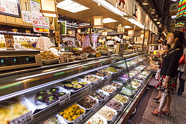 Customers wait at counter of local Japanese food stall, Nishiki Market (Kyoto's Kitchen), Downtown Kyoto, Japan, Asia