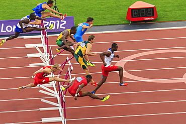 Competitors in Men's 110m hurdles semi-final clear hurdles, London 2012 Stadium, Summer Olympic Games, London, England, United Kingdom, Europe