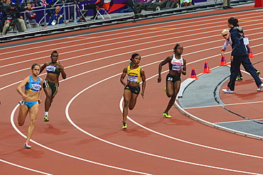 Shelly-Ann Fraser-Pryce, Jamaica, runs the bend in the Women's 200m round 1, London 2012, Summer Olympic Games, London, England, United Kingdom, Europe