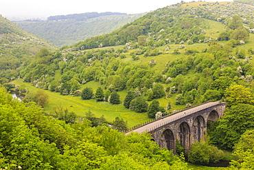 Monsal Trail viaduct, Monsal Head, Monsal Dale, former rail line, trees in full leaf in summer, Peak District, Derbyshire, England, United Kingdom, Europe