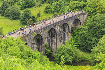 Monsal Trail, crowded with cyclists, former rail line viaduct over Monsal Dale at Monsal Head, Peak District, Derbyshire, England, United Kingdom, Europe