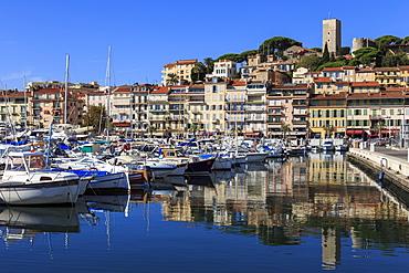 Reflections of boats and Le Suquet, Old (Vieux) port, Cannes, Cote d'Azur, Alpes Maritimes, Provences, France, Mediterranean, Europe