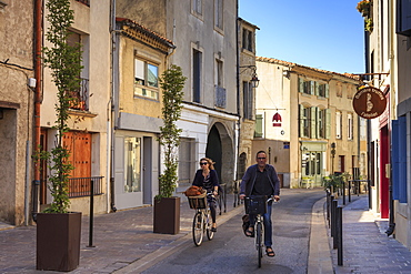 Cyclists in a Ville Basse narrow street, Carcassonne, Languedoc-Roussillon, France, Europe