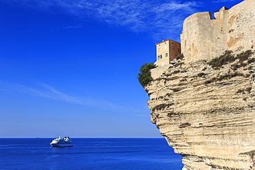 Old citadel atop cliffs with cruise ship anchored off shore, Bonifacio, Corsica, France, Mediterranean, Europe