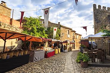 Gorgeous medieval village, market on cobblestone street with flags, Peratallada, Baix Emporda, Girona, Catalonia, Spain, Europe