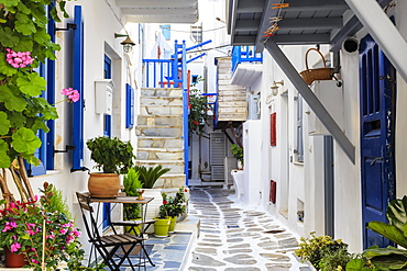 Narrow street, whitewashed buildings with blue paint work, flowers, Mykonos Town (Chora), Mykonos, Cyclades, Greek Islands, Greece, Europe