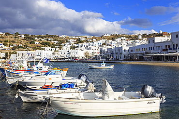 Small boats in harbour, whitewashed Mykonos Town (Chora) with windmills on hillside, Mykonos, Cyclades, Greek Islands, Greece, Europe