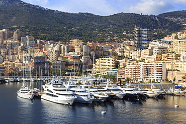 Pastel hues of the glamorous harbour of Monaco (Port Hercules) with many yachts, view from the sea, Monte Carlo, Monaco, Cote d'Azur, Mediterranean, Europe