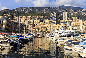 Vivid hues of the glamorous harbour of Monaco (Port Hercules) with many yachts and reflections, Monte Carlo, Monaco, Cote d'Azur, Mediterranean, Europe