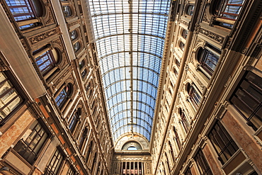 Morning light illuminates the Galleria Umberto I arcade, 1890, through its spectacular glass vaulted roof, City of Naples, Campania, Italy, Europe