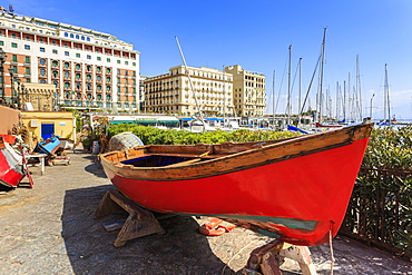Colourful rowing boats under repair at the marina Borgo Marinaro, with backdrop of grand hotels, Chiaia, City of Naples, Campania, Italy, Europe