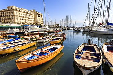 Yachts and colourful rowing boats in the marina Borgo Marinaro, Vesuvius in distance, Chiaia, City of Naples, Campania, Italy, Europe