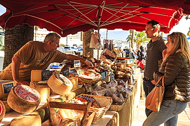 Customers being served at a stall of local meat and cheese in the market, Port of Ajaccio, Island of Corsica, Mediterranean, France, Europe